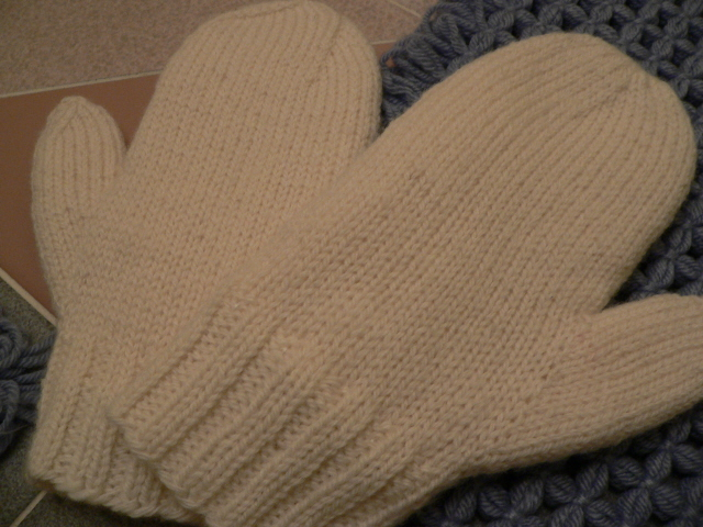 These are 100% wool knit mittens, lined with fleece fabric.